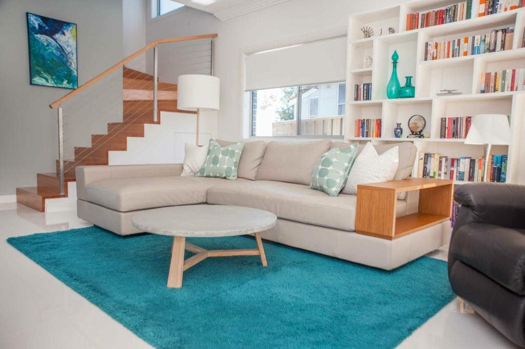 Couch with blue rug beneath