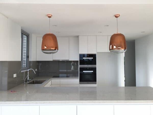 Fantastic copper pendant lights above kitchen counter