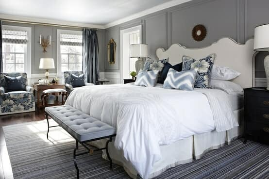 Scatter cushions with pattern bring interest to this bed