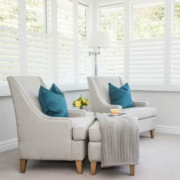 Two grey chairs with blue cushions - Linfield project by Anoushka Allum Interior Designer