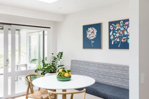 Blue art in dining room with fruit on table